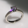 Tapered, channel set diamond ring