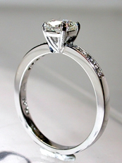 Cushion cut platinum diamond ring with pave' shoulders