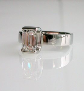 Modern bar-set emerald cut diamond ring