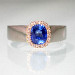 Gold Ceylon sapphire ring with fine diamond halo