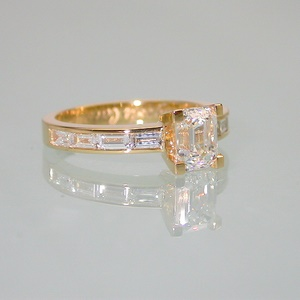 Yellow gold emerald cut and baguette diamond ring