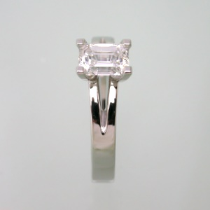 Elegantly styled emerald cut diamond ring