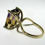 Amatrine dress ring with citrine and amethyst sides