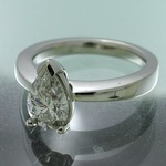 Heavy platinum pear shape diamond ring, hand wrought