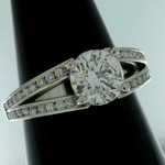 Platinum diamond ring, open at the shoulders