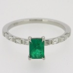 Fine emerald ring with bar set diamonds in platinum