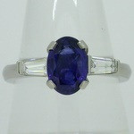 Blue sapphire with tapered baguette, diamond shoulders