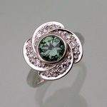 Green sapphire with vortex diamond halo