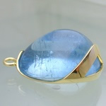 Large blue aquamarine set in sculptured gold setting