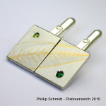 24k and Palladium cuff link set with leaf motif and green sapphires