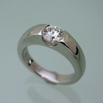 Solid platinum diamond ring with U curve setting