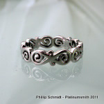 Hand pierced and engraved matched infinity wedding set