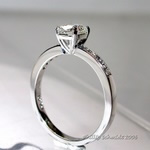 Cushion cut platinum diamond ring