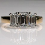 Three stone emerald cut diamond ring